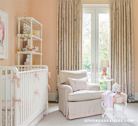 pink nursery with pink and beige nursery glider