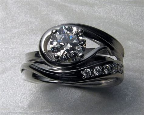 very unusual custom made engagement ring with matching