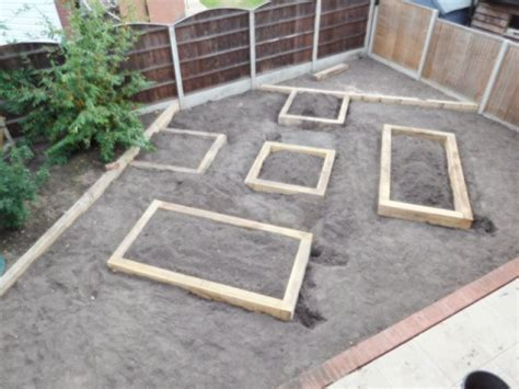 new oak railway sleepers raised bed gravel garden