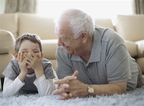 grandfather s boy and grandfather lying on floor and laughing 187 sanitas