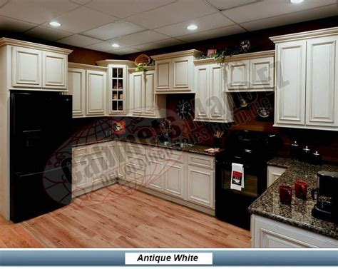 white glazed cabinets with black appliances kitchen