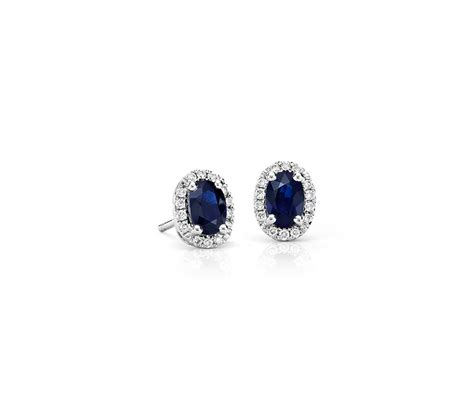oval sapphire and halo stud earrings in 18k white