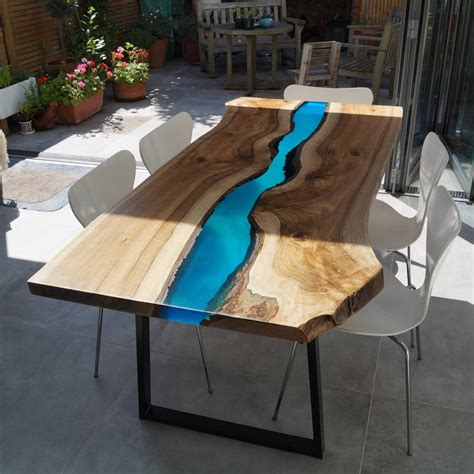 wood and resin table resin river dining table by revive joinery