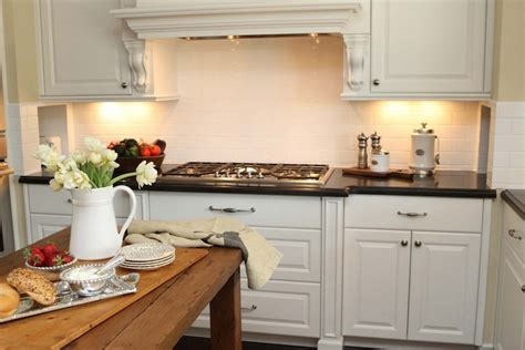 Kitchen Range Hood Design Ideas by Honed Black Countertops Transitional Kitchen The