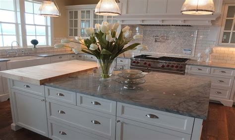 White kitchen with gray subway tile, gray quartzite