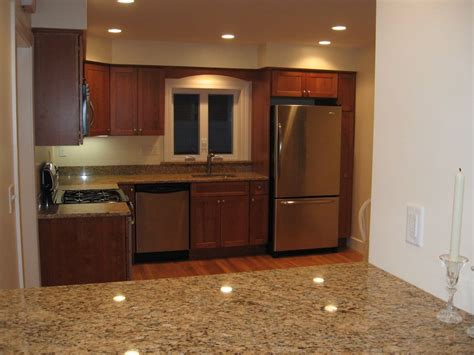 black stainless appliances with cherry cabinets renovated kitchen with granite counters cherry cabinets