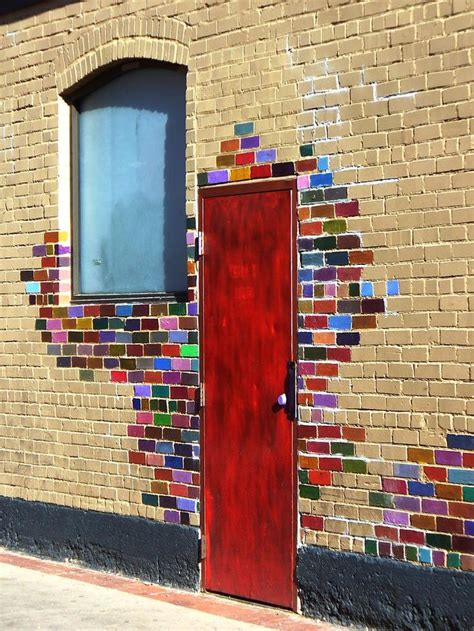 colorful doors painting bricks around your front door is a great way to