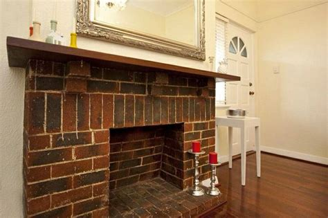 1940s Fireplace by Brick Fireplace In 1940s Deco Apartment