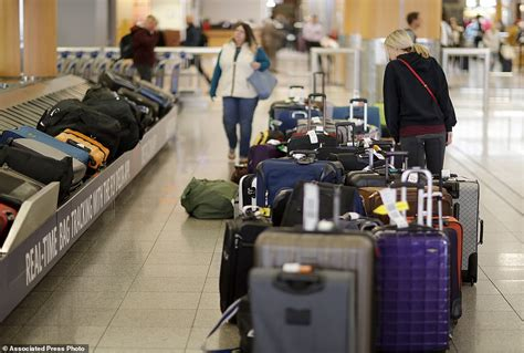 baggage laid out at airline luggage counter after flight pictured burned out equipment inside atlanta s airport