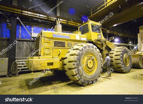 Bigyellow Lookup Big Yellow Tractor In A Workshop Stock Photo 5365051