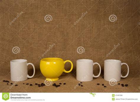 White Coffee 1 Renteng coffee mug background white mugs and beans royalty free