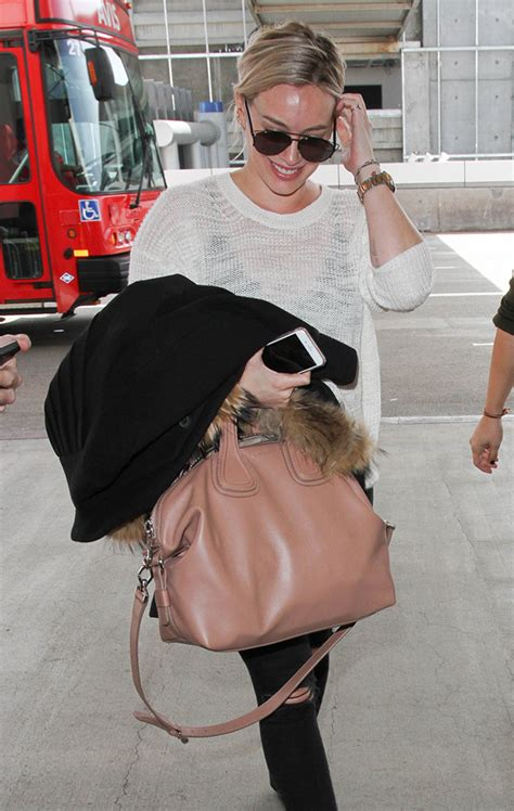 Hilary Duffs Marc Purse by Now Decided That Bright White Bags Are Totally