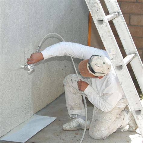 spray painter labourer should you spray or brush paint the exterior of your house