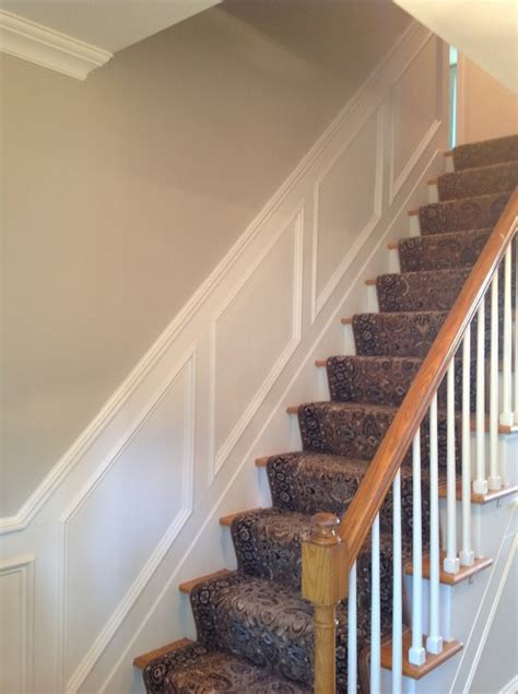 paint plus had moulding added to entryway stairs and hallway