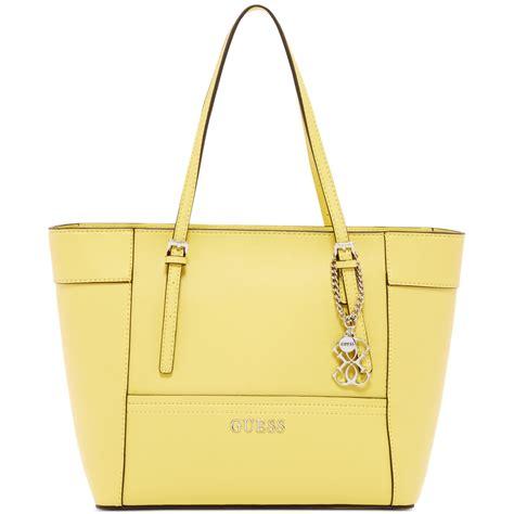 Tas Guess Delaney Mini Original Bag lyst guess delaney small classic tote in yellow