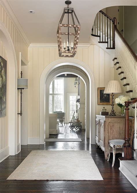 traditional foyer  archway foyer beautiful foyer  archways  rustic dark hardwood