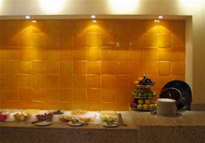 mexicantiles backsplash with yellow mexican tile
