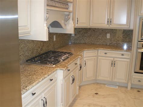 kitchen cabinets with granite countertops new venetian gold granite with white cabinets kitchen venetian gold granite