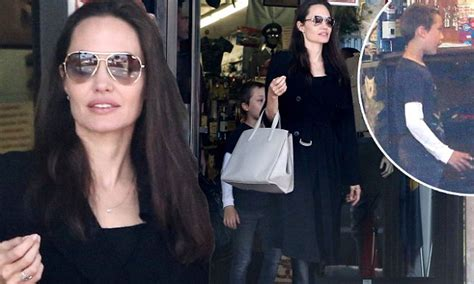 angelina jolie brings son knox to military supply store angelina jolie brings son knox to military supply store