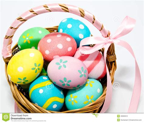colorful handmade easter eggs in the basket isolated stock