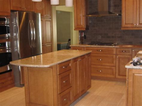 quartz countertops with maple cabinets maple cabinetry w cambria quartz countertop