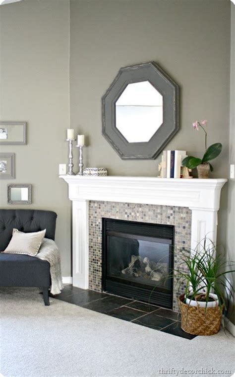 How To Redo A Fireplace Mantel by 25 Best Ideas About Tile Around Fireplace On