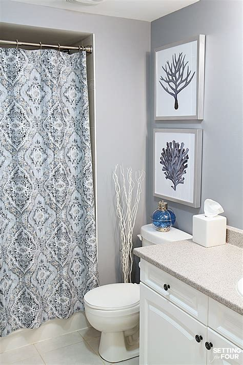 bathroom artwork ideas height measurements and how to hang pictures in a bathroom