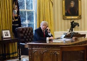 trump oval office desk trump kept sanctions out of putin chat tried to assure