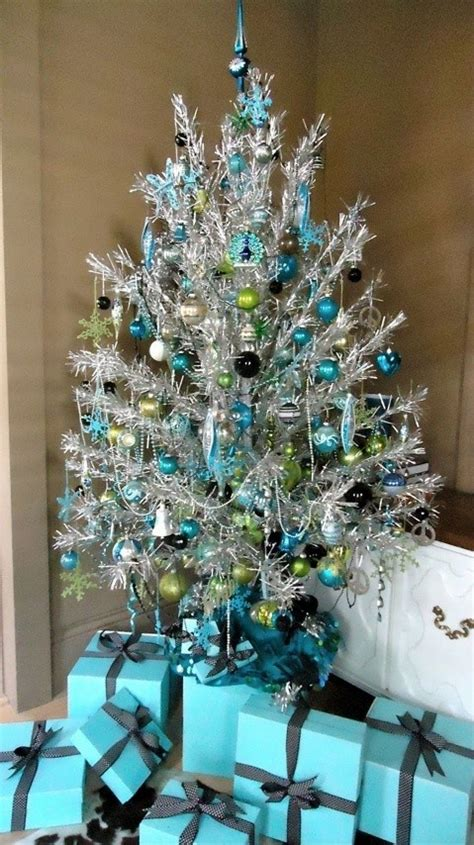 christmas tree decorations in blue and silver christmas