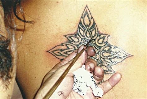 starcat tattoo koh samui beautiful flower on back pattern big magic tattoo koh