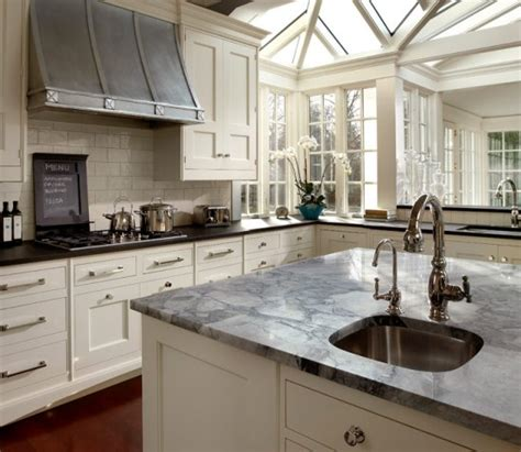 small white kitchen with steel hood bungalow blue interiors home 10 dramatic range hoods