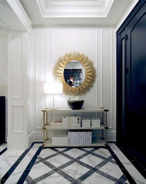entrance hall  statement sunburst mirror  marble