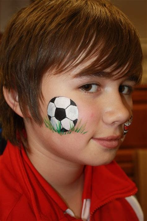 soccer ball with flames boy s face painting by let s sports entertainer hire attraction event services