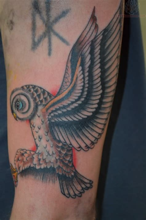 flying owl tattoo flying owl on muscles