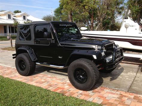 blacked out jeep i want those fender flares the blacked out top it