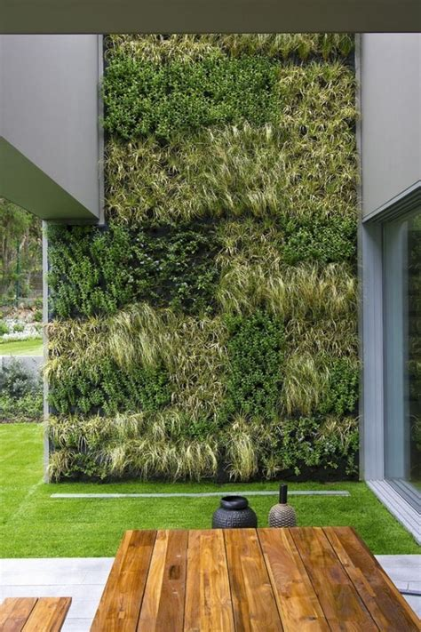 15 Inspiring Vertical Garden Designs Outdoortheme Com Vertical Garden Design Ideas