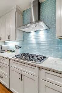 blue glass kitchen backsplash the reflective quality of this kitchen s blue glass tile backsplash is a perfect compliment to