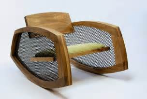 Low wooden rocking chair to fit any modern interior by brendan