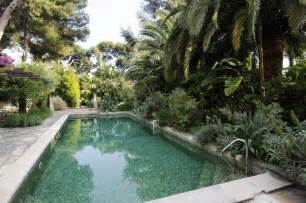 pool landscape surrounded by greenery olpos design