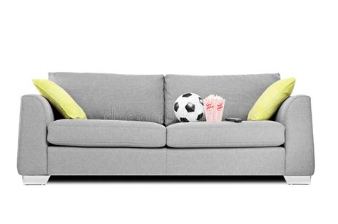 soccer ball couch studio shot of a modern couch with soccer ball and popcorn