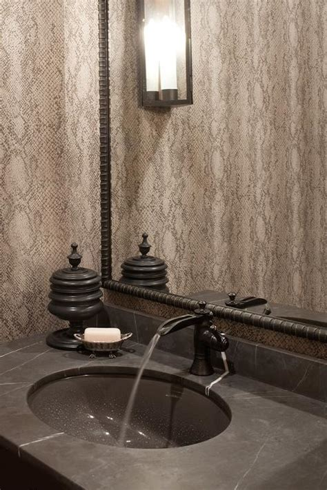 gray and black powder room with soapstone countertop