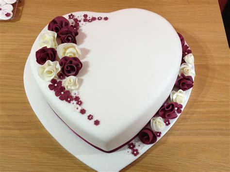 design love fest flower cake heart shaped wedding cake with whimsical flowers fondant