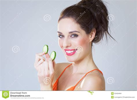 girl with cucumber girl with cucumber slices stock photo image 53429484