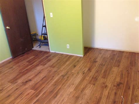 Distressed Hickory Laminate Flooring Home Depot - distressed brown hickory pergo flooring and behr s