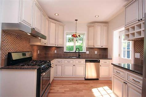 white glazed maple kitchen cabinets and bathroom vanities