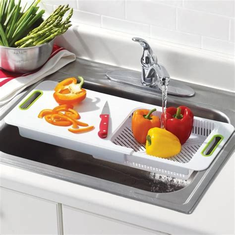 kitchen sink with cutting board and colander over the sink cutting board with colander avon https