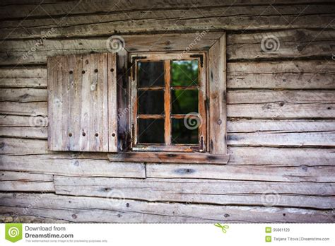 small house windows small window in the wall of an old wooden house stock