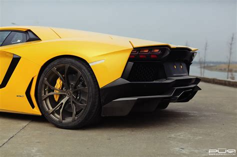 yellow lamborghini aventador bright yellow lamborghini aventador on bronze pur wheels