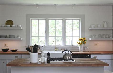 under cabinet open shelves sink kitchen pinterest note large window over sink open shelving butcher
