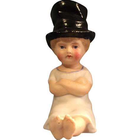 bisque doll in german bisque sitting child doll in top hat from